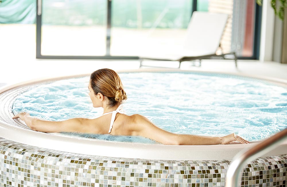 Woman sitting in jacuzzi
