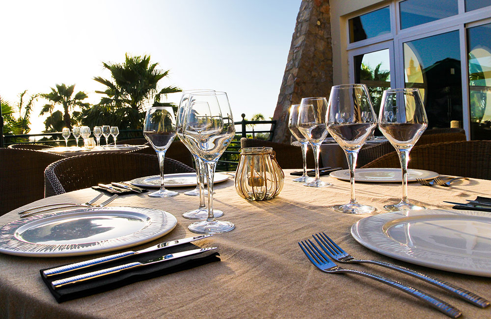 View of table, plates and glasses at Quinta Heights restaurant