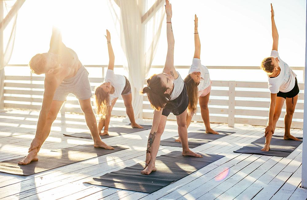 Group doing rooftop yoga